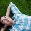 Happy young man lying in the grass — Stock Photo #9961842
