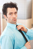 Executive adjusting his tie outside — Stock Photo