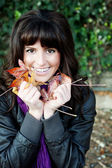 Pretty young girl with autumn leaves — Stock Photo