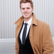 Portrait of a happy young businessman with trench coat — Stock Photo #9975021