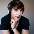 Portrait of young man with headphones listening to music — Stock Photo #9975292