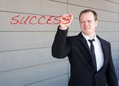 Homme d'affaires, le succès du mot d'écriture sur l'écran — Photo