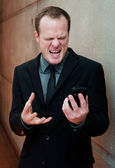 Angry businessman, yelling at cell phone — Stock Photo
