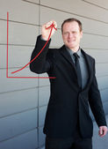 Professional businessman drawing a growth curve — Stock Photo