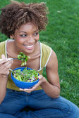 Pretty African American woman eating a salad — Stock Photo