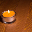 Candle on wooden table — Stock Photo