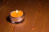 Candle on wooden table — 图库照片