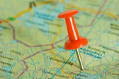 Red pushpin in a map — Stock Photo