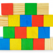 Colourful wall from toys wooden cubes — Stock Photo