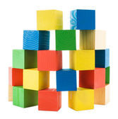 Wooden colored big cubes tower — Stock Photo