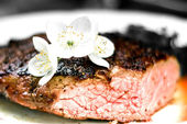 Fresh meat steak with flower — Stock Photo