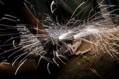 Spinning disk of circular saw with sparks — Stock Photo