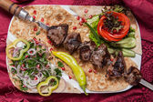 Fried beef kebab on a skewer with vegetables — Stock Photo