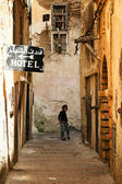 Narrow street and cheap hotel in Marocco — Stock Photo