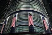 Malaysia flag on Petronas Towers — Stock Photo