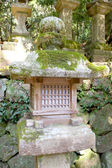 Japanese stone old lantern covered by moss — Stock Photo