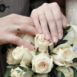 Hands of newlywed couple with bouquet — Stock Photo #9801854