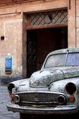 Old blue car in yard — Stock Photo