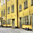 Stock Photo: Old Town alley with yellow buildings.