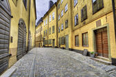 Old Town street with yellow houses. — Stock Photo