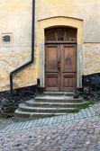 Door on an old cobblestone street. — Stock Photo