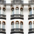 White vintage facade with balconies. — Stock Photo #9845951