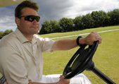 Golf cart driver — Stock Photo