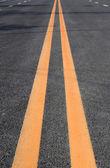 Double yellow lines — Stock Photo