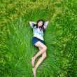 Stock Photo: Asicute girl lying on meadow