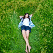 Asian cute girl lying on meadow — Stock Photo #10480616
