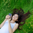 Asian cute girl texting on meadow — Stock Photo #10481903