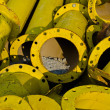 Pile of old yellow steel pipe — Stock Photo #10488302
