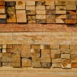 Stock Photo: Stack of lumber in timber logs storage