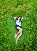 Asian cute girl lying on meadow — Stock Photo