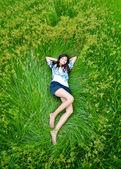 Asian cute girl lying on meadow — Stock Photo