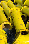 Stack of yellow steel pipe — Stock Photo