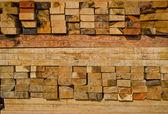 Stack of lumber in timber logs storage — Stock Photo