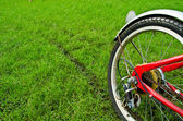 The red bicycle's wheel with it's track — Stock Photo