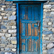 Blue door on the stone wall — Stock Photo