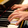 Hand of a piano player - Stock Photo