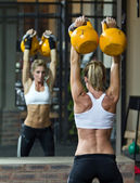Kettlebells in the gym — Stock Photo