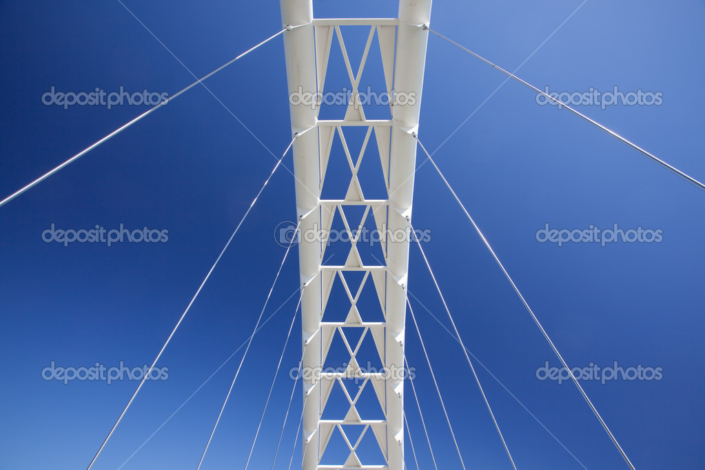 Looking up at the top of a pedestrian bridge against a blue sky. This is the Lakeshore footbridge in Toronto. — Stock Photo #10082460