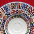 Colorful plates on red — Foto Stock #9796294