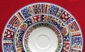 Colorful plates on red — Foto Stock