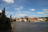 Prague castle and Charles bridge — Stok fotoğraf