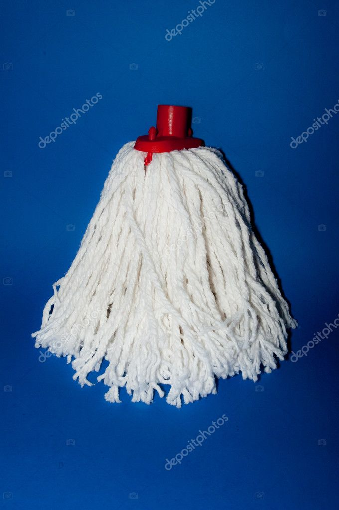 A white new mop isolated in blue — Stock Photo #10565578