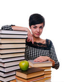 Girl with stack of books and apple — Stock Photo