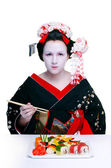 Geisha and sushi — Stock Photo