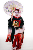 Geisha with umbrella — Stock Photo