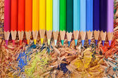 Multicolor pencils raibow on the shavings — Stock Photo